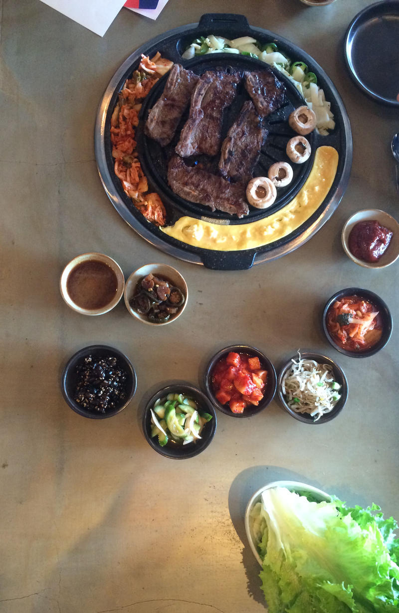Seoul Q offers several meats, like LA beef, and several side items, including vegetables and egg soufflé , and sauces.