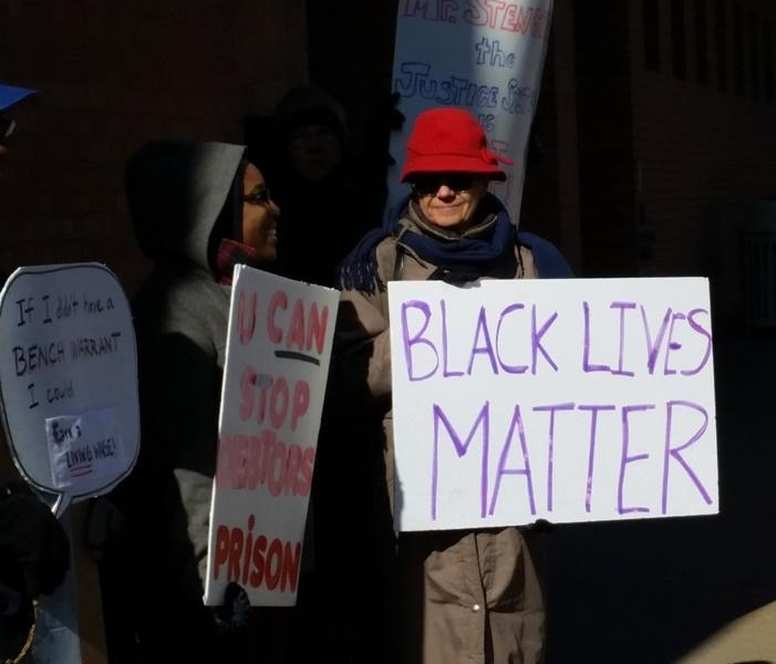 Protesters outside St. Louis County headquarters on Feb. 2, 2015 call for reforms of the municipal court system.