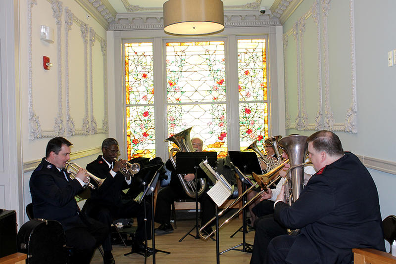 The Salvation Army band plays in an alcove of the newly renovated apartment building on Washington Ave. on Friday, February 27, 2015.