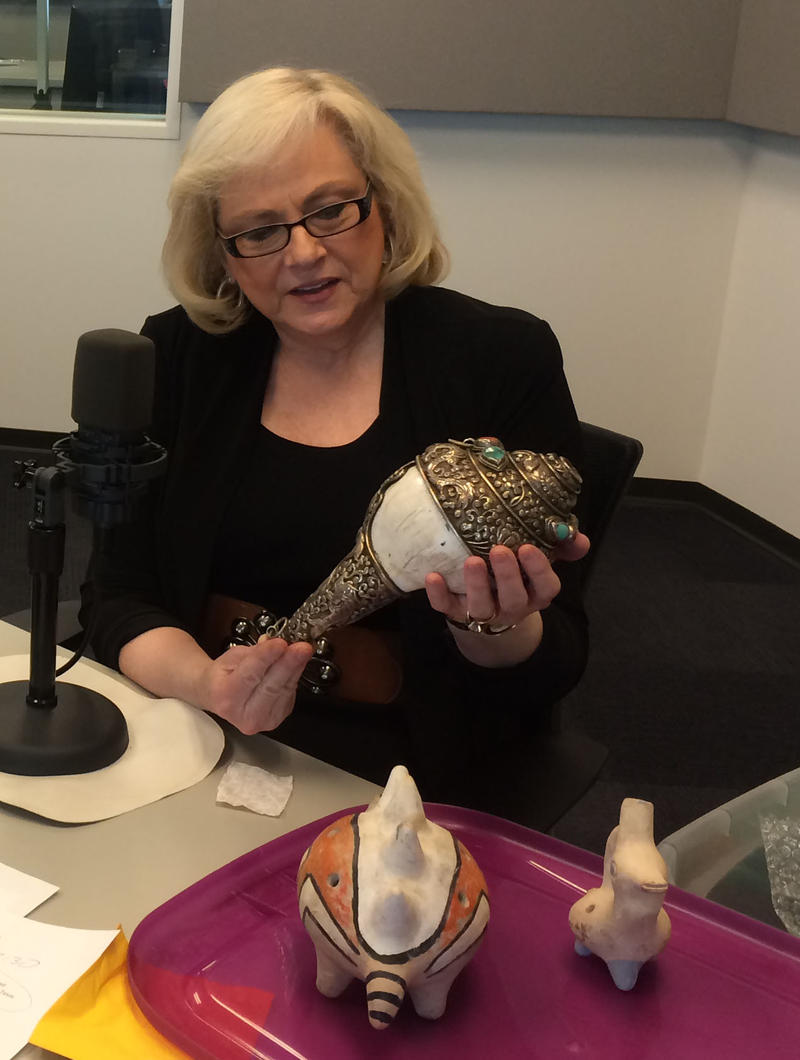 Aurelia Hartenberger holds a Nepalese shell horn, a seashell encased in silver, on Feb. 6, 2015, on 'Cityscape.'