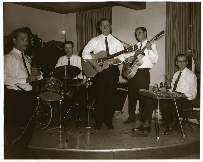 This photo of St. Louis' Big Red Burlecamp was taken in St. Charles in 1963. Big Red is in the center, with guitar.