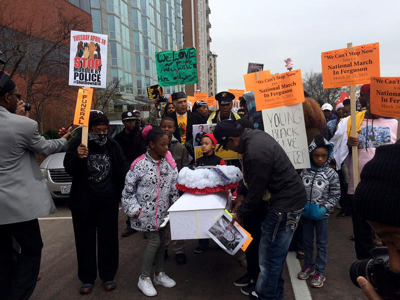 The protest in Clayton Friday, March 20, 2015 had a funeral theme, complete with a white casket carried through the streets.