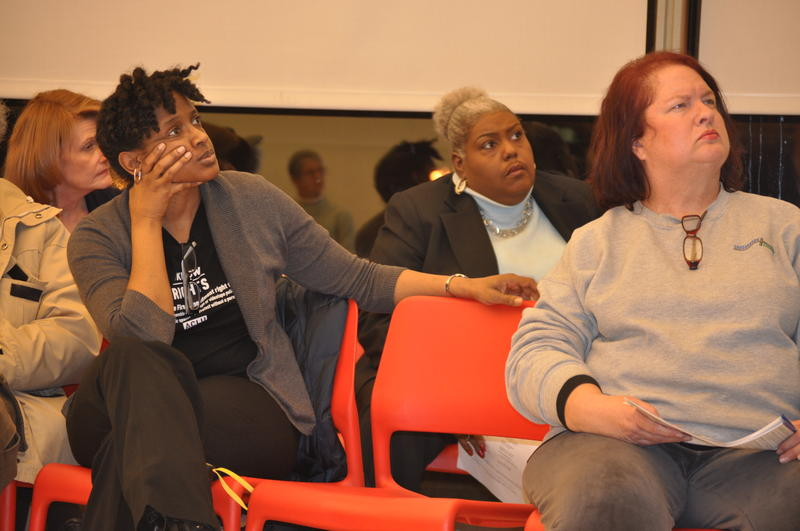 A participant listens to the discussion during a focus group following the Ferguson Commission meeting.