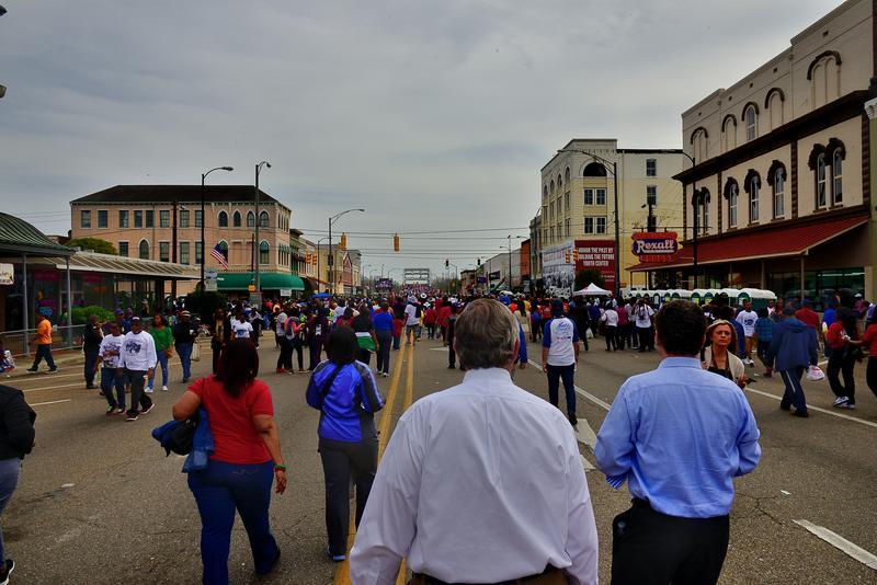 Greg Vatterott Jr. and Greg Vatterott Sr. walk through Selma, Ala., toward the Edmund Pettus Bridge on March 7, 2015.