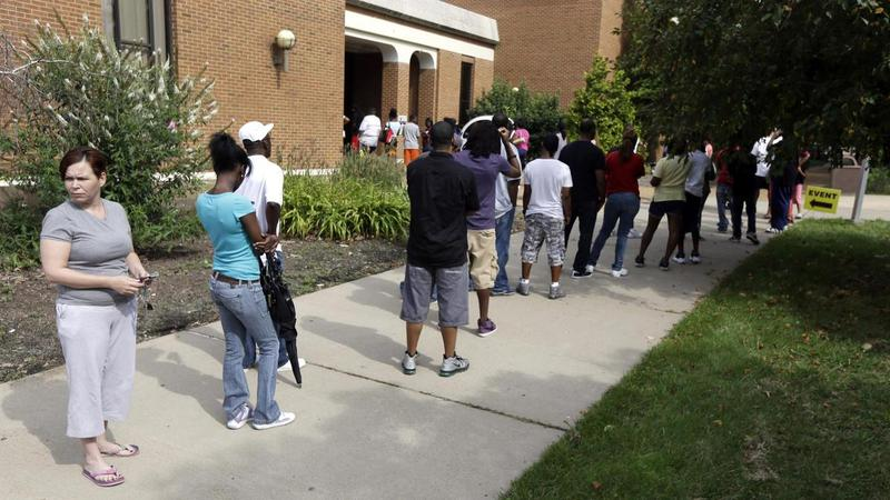 People line up to take part in an amnesty program to clear up outstanding misdemeanor arrest warrants in August 2013 in Ferguson.