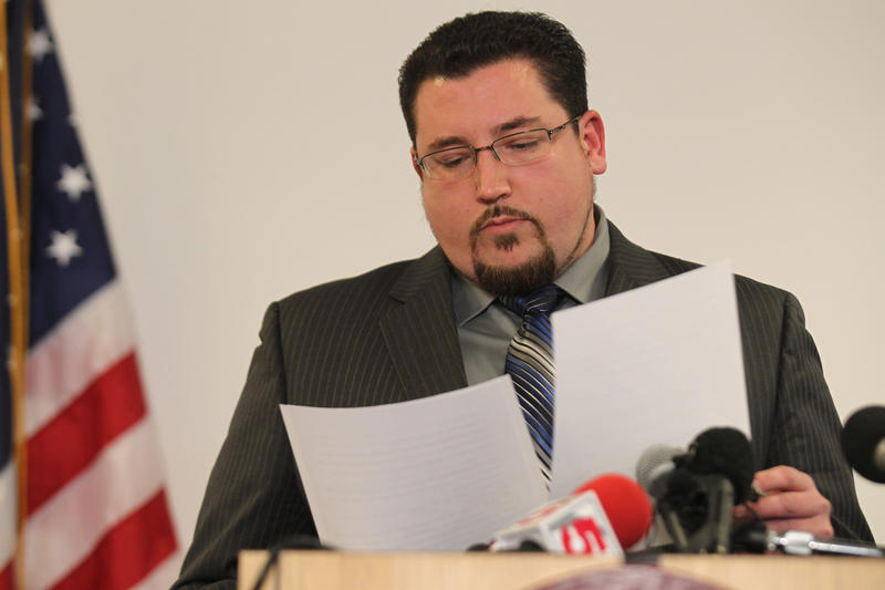 Ferguson Mayor James Knowles reads from a prepared text reacting to a Department of Justice report on his city. Knowles did not answer questions from the media.