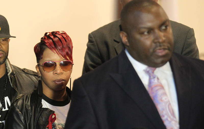 Michael Brown's mother, Lezley McSpadden, listens on March 5, 2015, as attorney Daryl Parks announces the family's intent to sue former police officer Darren Wilson and the city of Ferguson for her son's death.