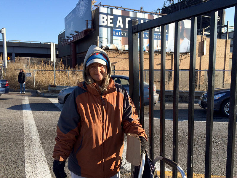 Sherry Branham, 55, panhandles at the eastbound I-64 exit ramp onto Grand Blvd.