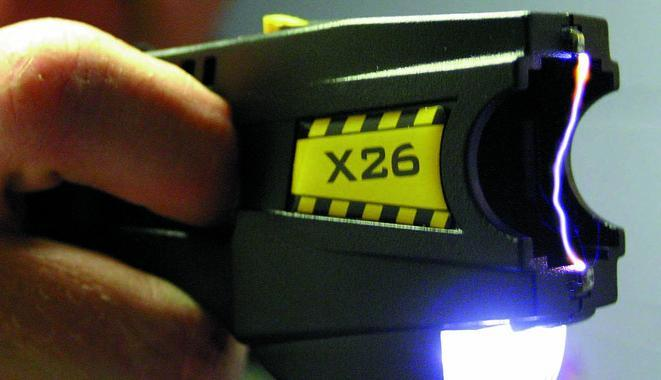 A Taser, with cartridge removed, making an electric arc between its two electrodes