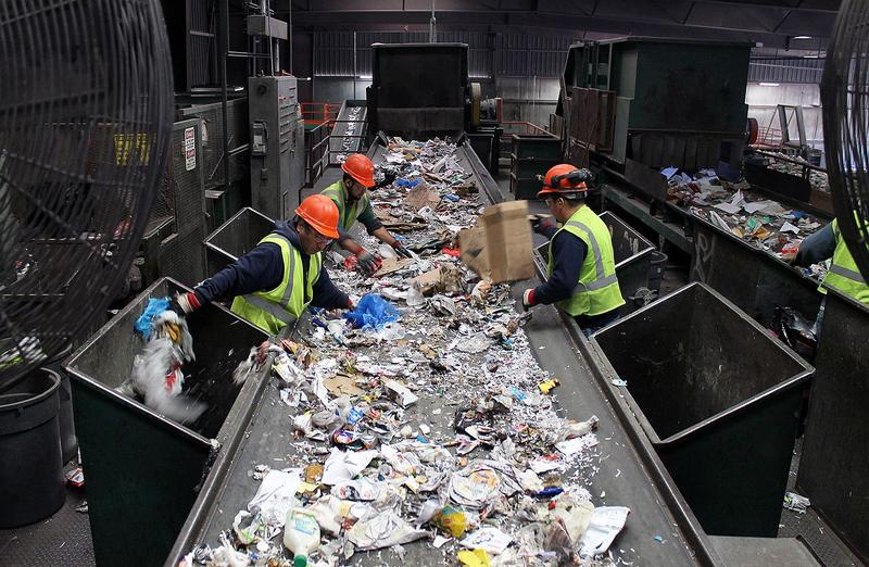 At Resource Management's MRF, workers pull plastic bags, other trash and large pieces of cardboard off the conveyor belts before the mixed recyclables enter the sorting machines.