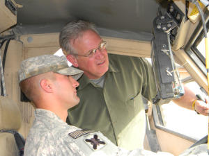 A soldier shows Gov. Nixon a MRAP vehicle (Mine Resistant Ambush Protection).