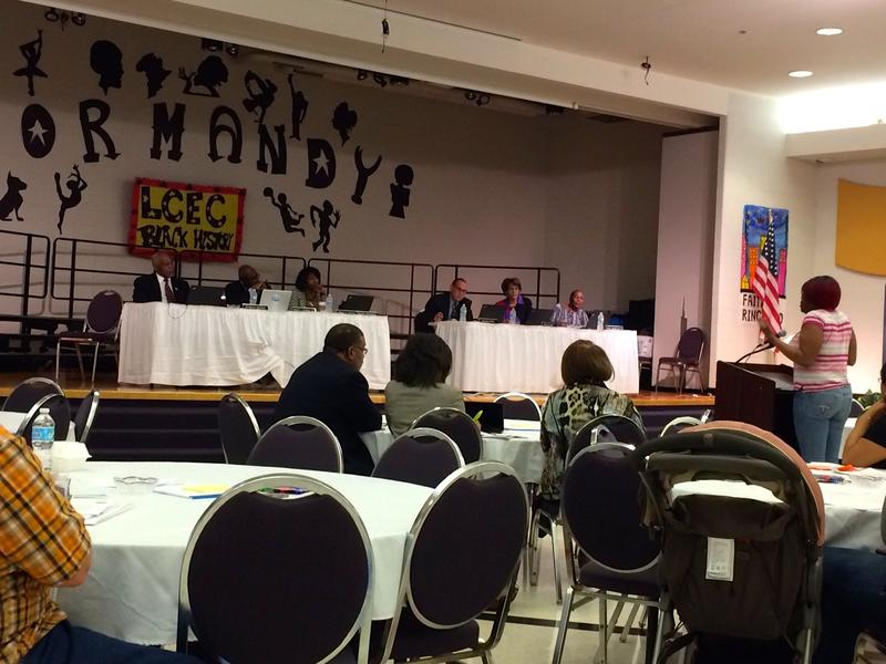 The Normandy school district board listens to public comment at Thursday night's meeting