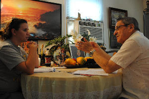 Pamela Vanegas and Manuel Torres discuss civics in their final study session before the 81-year-old takes his citizenship test.