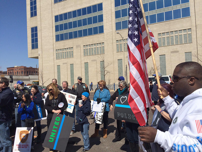 Between 80 and 100 people rallied in support of law enforcement Saturday, March 28, 2015 outside the headquarters of the St. Louis Metropolitan Police.