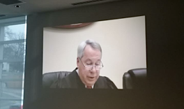 Appeals Court judge Roy Richter was on the bench in Ferguson for the first time on March 19. Video screens were set up in another building to accommodate those who wanted to watch the court but did not have cases.