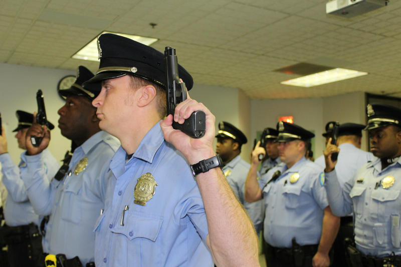 St. Louis Metropolitan Police officers raise their weapons at a preshift meeting 3.23.15