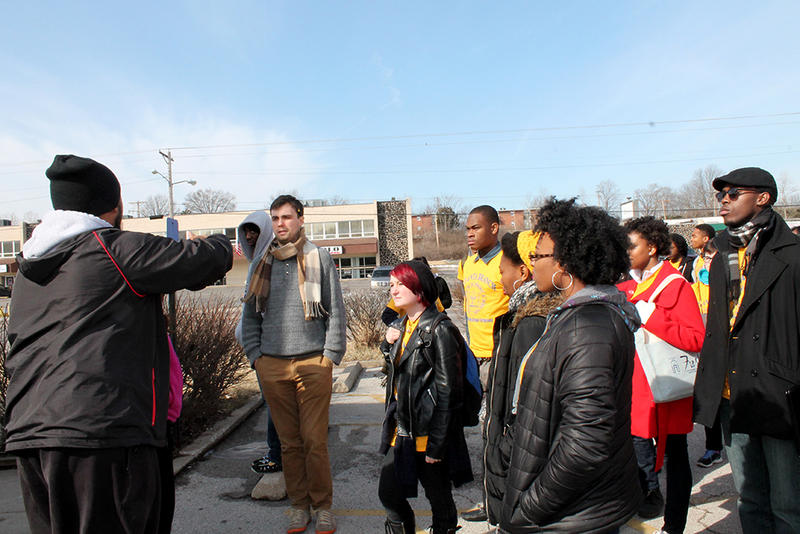 Ferguson activist Charles Wade, left, gives Atlanta students a tour of W. Florissant Ave. before they start the voter registration drive on Sunday, March 8, 2015.