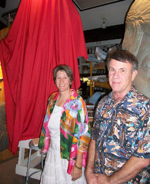 Francesca Williams and sculptor Don Wiegand stand before a shrouded mockup of the proposed statue of Tennessee Williams.