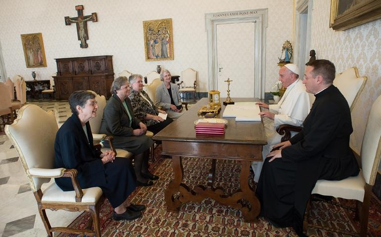 Pope Francis meets with four representatives of the Leadership Conference of Women Religious in the Vatican April 16.