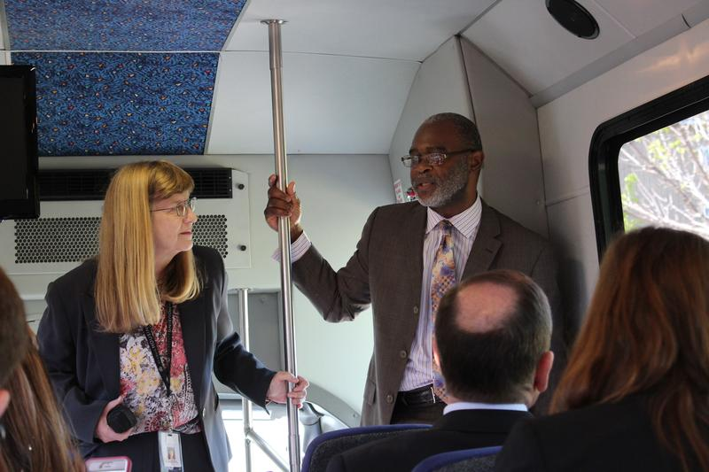 James Heard, HUD's St. Louis field officer, directs a bus tour of north St. Louis on Tuesday.