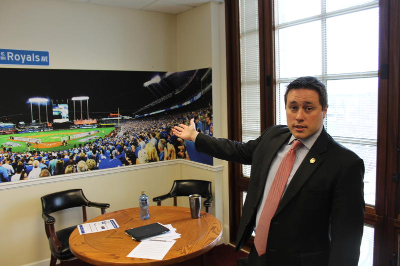 State Sen. Ryan Silvey shows off his panaromic picture of Kauffman Stadium in Kansas City. Silvey is part of a growing chorus of policymakers that want some sort of vote on extending bonds for a new stadium.
