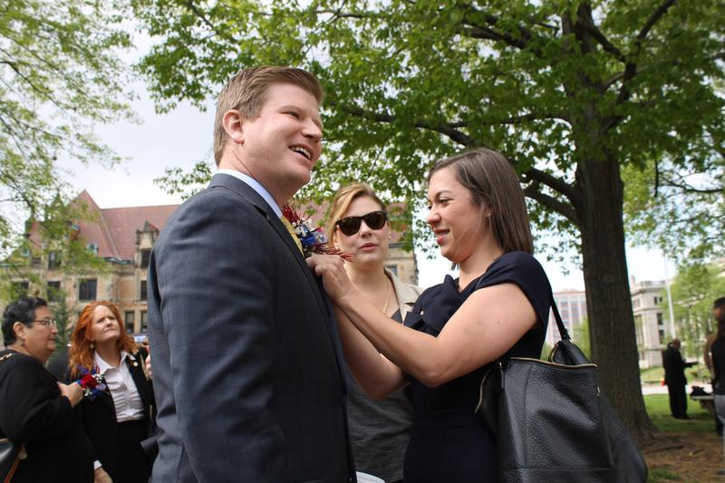 Alderman Jack Coatar, D-7th Ward, receives some help with his corsage. Coatar won a three-way race for the ward that includes most of Downtown St. Louis.