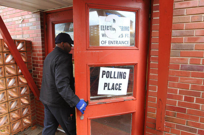 A voter enters Our Lady of Guadalupe School on election day in Ferguson.