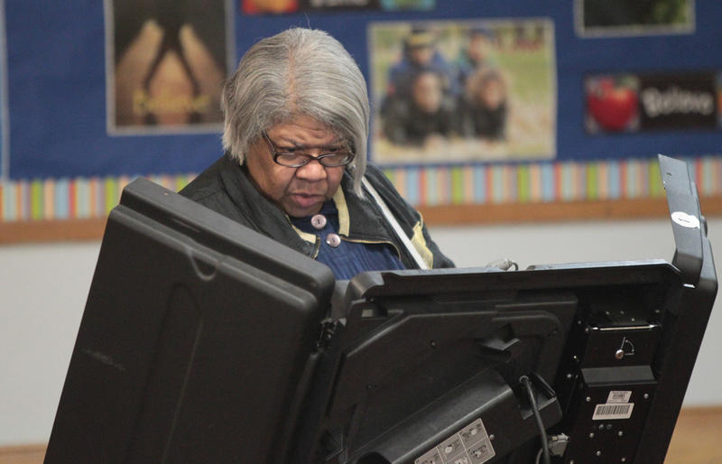 A woman casts her vote on election day in Ferguson on April 7, 2015.