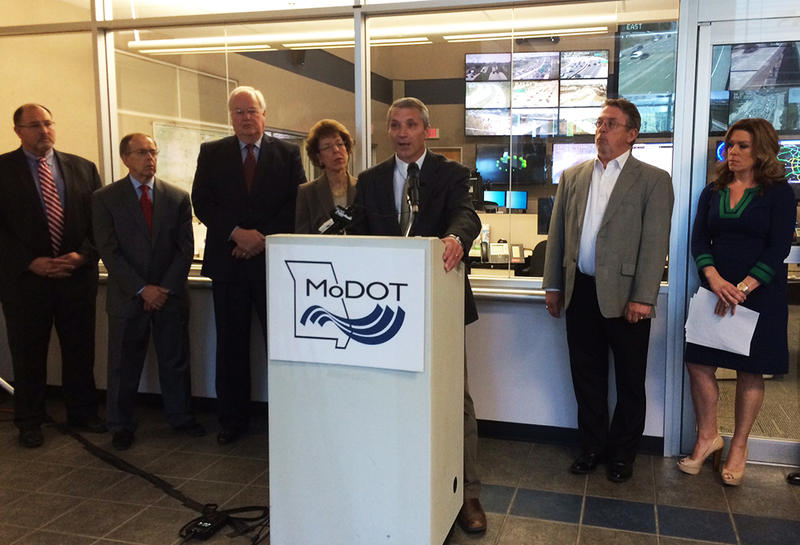 MoDOT District Engineer Greg Horn speaks at the TRIP report news conference Thursday, April 30, 2015 against a backdrop of the traffic management center in Chesterfield.