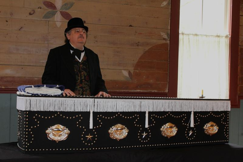 The replica coffin was unveiled recently at an event in Elsah, Ill. George Provenzano portrayed Washington undertaker Frank Sands who built Abraham Lincoln's coffin in 1865.