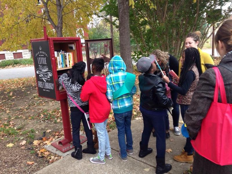 Children use a Little Free Library in North St. Louis.
