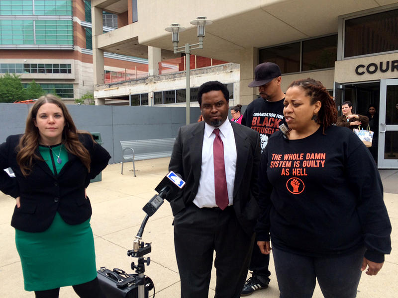 Attorney Maggie Ellinger-Locke and activists Montague Simmons and Juliette Jacobs speak at news conference after the hearing Friday, April 24, 2015.