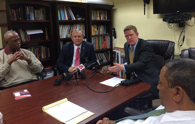 Retired Circuit Judge Milton Wharton (left), St. Clair County Sheriff Richard Watson and St. Clair County State's Attorney Brendan Kelly spoke about ethics violations of the Brooklyn Police Department at a news conference on Wednesday, April 8, 2015.
