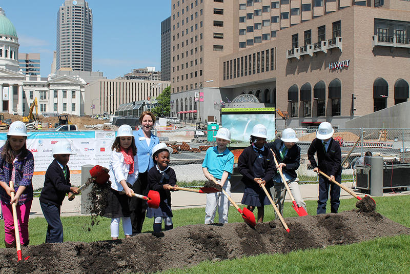 Elementary students from KIPP Victory Academy in St. Louis and Rockwood Center for Creative Learning in Ellisville break ground on the Arch museum expansion Wednesday, April 29, 2015. CityArchRiver Executive Director Maggie Hales looks on from back.