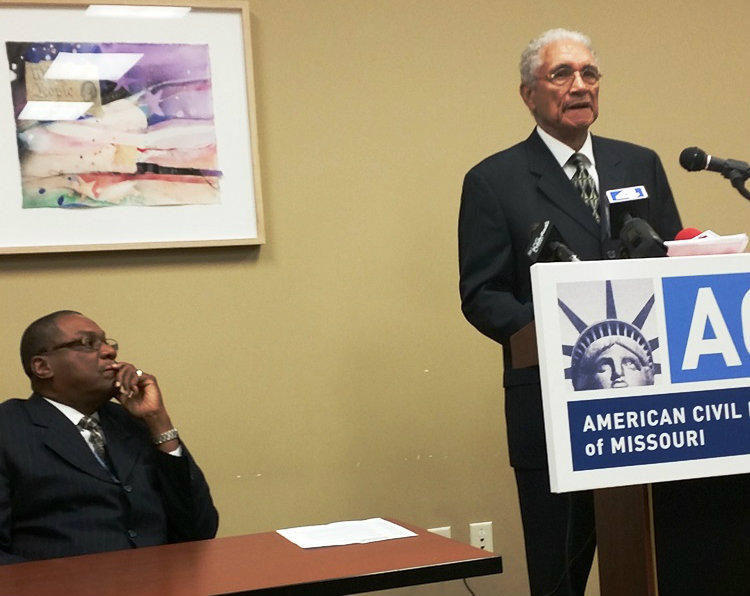 Adrian Wright, a former mayor of Pine Lawn, says his political opponent used the city's police department as a tool of political intimidation. Adolphus Pruitt of the NAACP is at left.