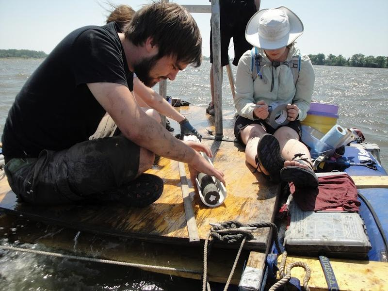 Geologists from the University of Wisconsin extrude a 6-meter sediment core from the deepest point of Horseshoe Lake.