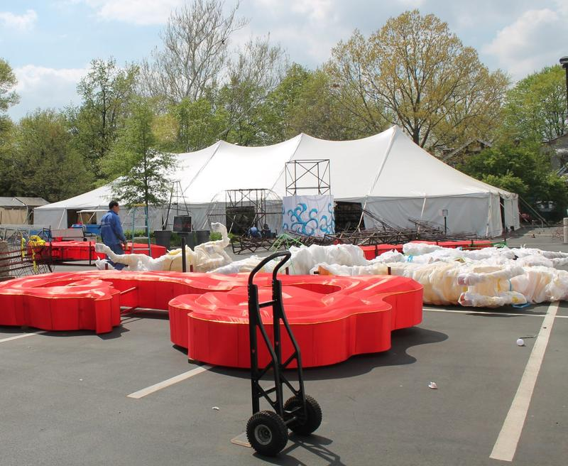 In April, lanterns were laid out in the parking lot ready for installation.