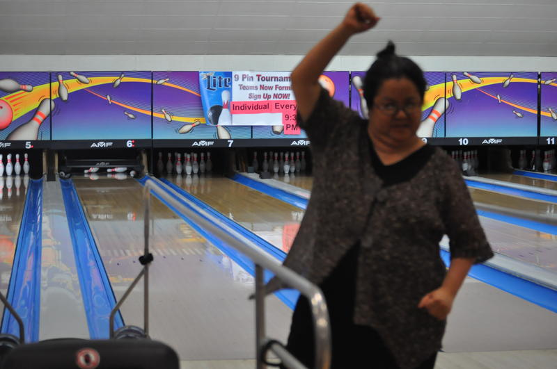 Soo McClure celebrates a successful round at the DuBowl Lanes in South St. Louis.