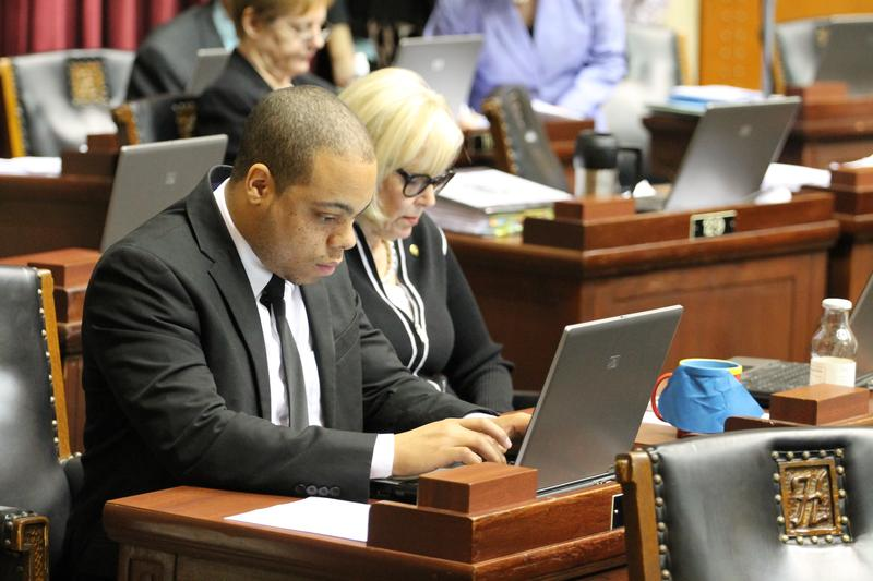 Reps. Michael Butler, D-St. Louis, and Stacey Newman, D-Richmond Heights, work at their desks on Wednesday. That's the day the KC Star broke the story about House Speaker John Diehl's texts with a 19-year-old intern.