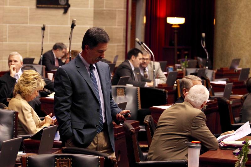 Rep. Mike Moon, R-Ash Grove, checks his phone on the Missouri House floor.