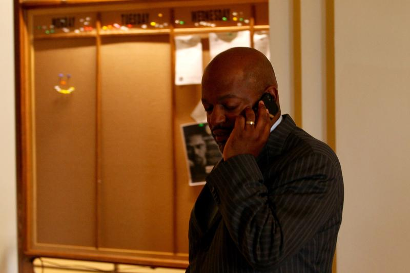 Lobbyist Rodney Hubbard talks on his cell phone on Wednesday. Hubbard, a former state representative from St. Louis, was lobbying against the right to work bill.
