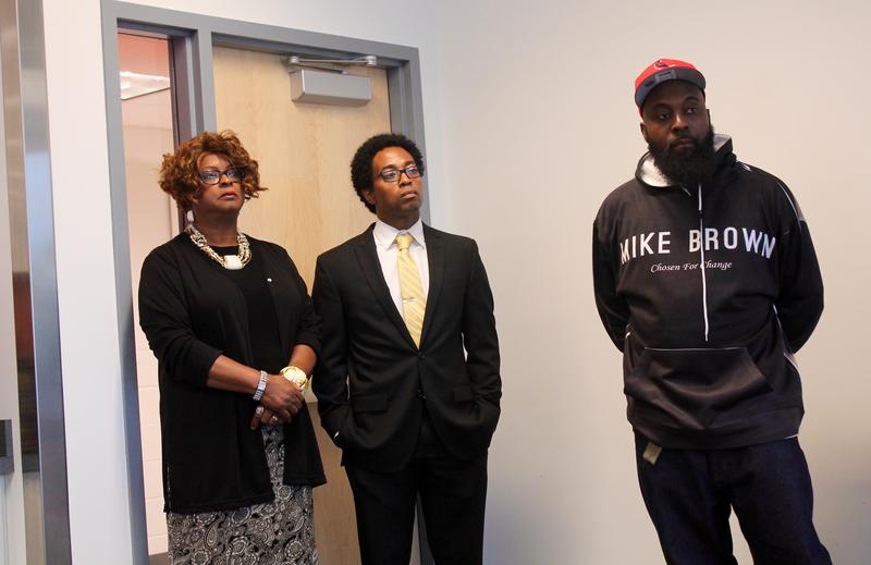 Brown, Sr., stands with Ferguson Councilpeople Ella Jones and Wesley Bell at a press conference announcing the dismantling of the Michael Brown memorial.