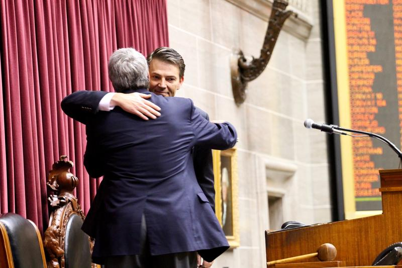 House Speaker Todd Richardson hugs his father, former House Minority Leader Mark Richardson. Mark Richardson almost became speaker in the 1990s after a Democratic revolt.