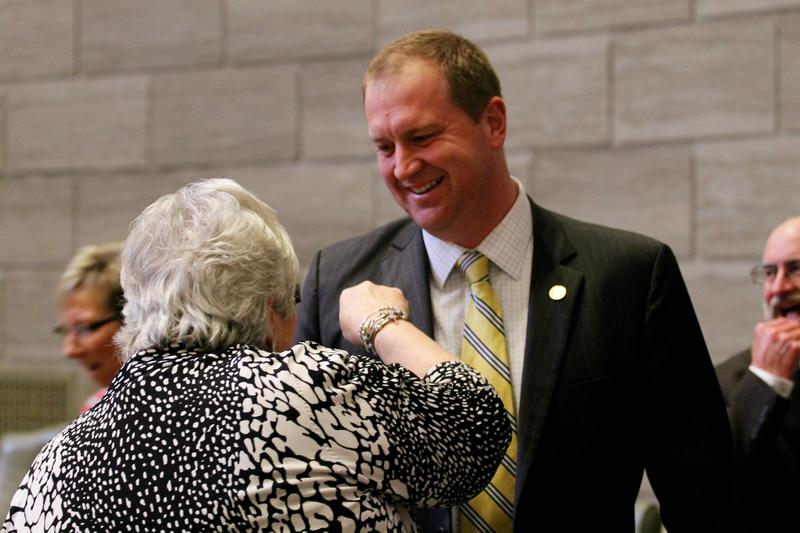 Schmitt laughs with Sen. Gina Walsh, D-Bellefontaine Neighbors, after the Senate adjourned for the year. The Senate adjourned three hours earlier than usual.