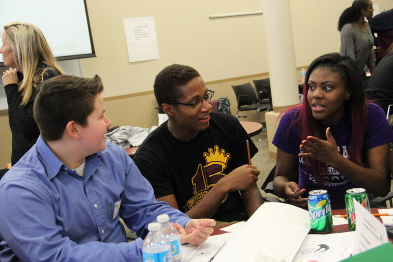 (From Left) Seckman Senior High School Kyle Edwards, Hazelwood East seniors Justin Mason and Teanna Bass pushed their tables together and created the winning idea for bridging racial divides in St. Louis.