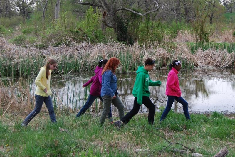 Mentor Laura Seger and the local SciGirls walk through a wetland.