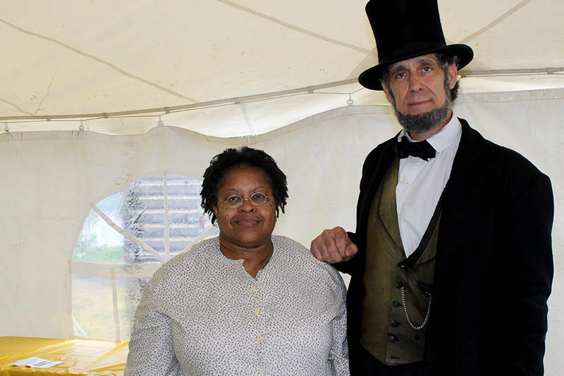 Lindenwood professor Angela da Silva organized the May, 9 2015 Mary Meachum celebration. She poses here with an Abe Lincoln reenactor so in character that he wouldn't acknowledge any other name.