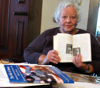 Elsie Roth shows off a book that describes her father's heroism during World War I, for which he was awarded the Distinguished Service Cross.