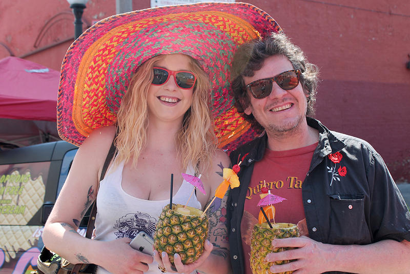 Lauren Stubbs and Johnny Vegas pose with drinks during Cherokee Street's Cinco de Mayo festival on Saturday, May 2, 2015. Vegas said the event was
