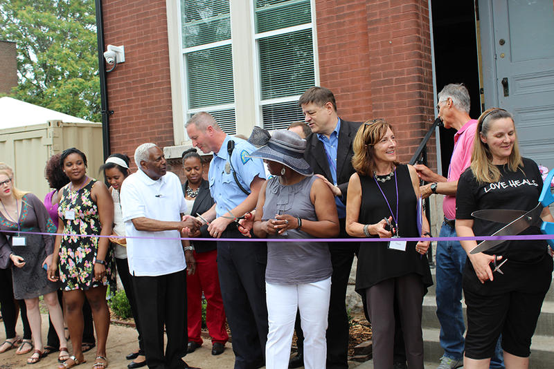 Magdalene St. Louis director Tricia Roland-Hamilton and sex traffic survivor Shelia McCain cut the ribbon for the opening of the Magdalene House in St. Louis' Old North neighborhood Saturday, May 30, 2015.